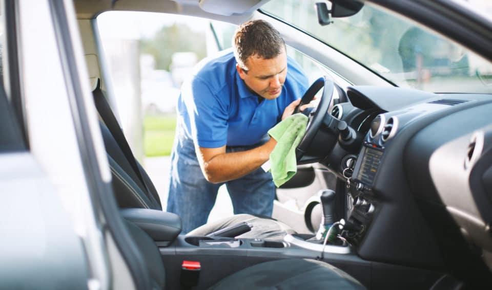 Man detailing his car