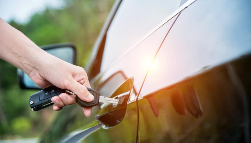Woman hand inserting key in car door Pelham, AL