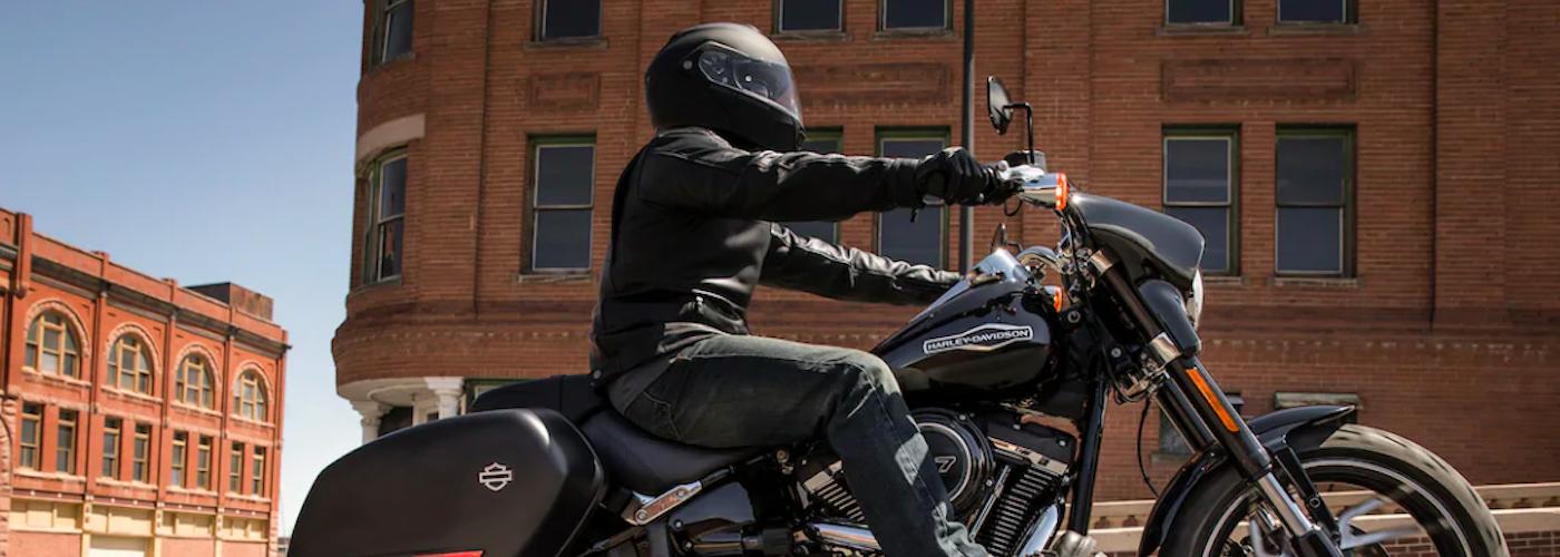 2020 harley-davidson street glide black and motorcyclist wearing helmet