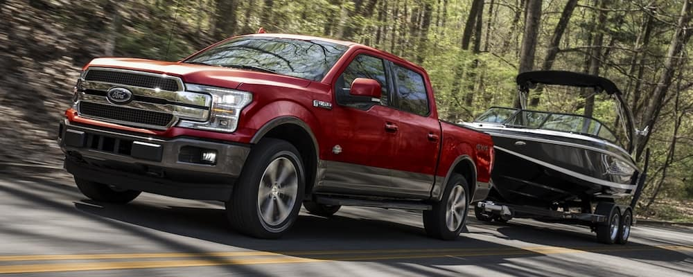 Red 2020 Ford F-150 Towing Boat