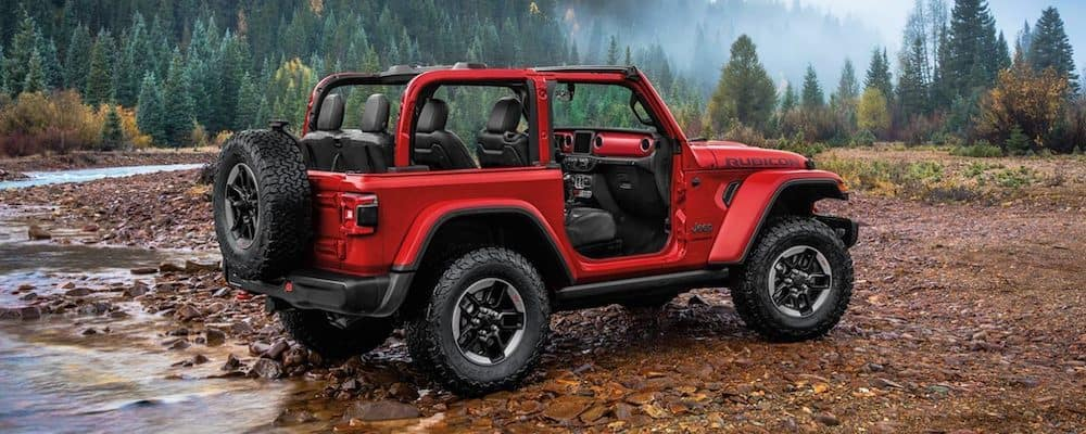 Red 2020 Jeep Wrangler Rubicon Parked on Rocks
