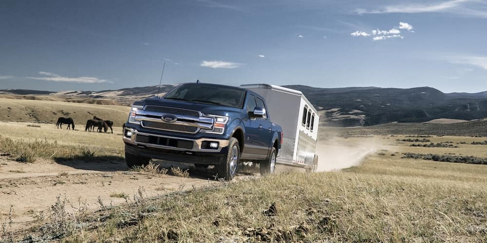 Blue 2020 Ford F-150 Towing Trailer