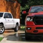 Red and white 2020 Ram 1500 in driveway