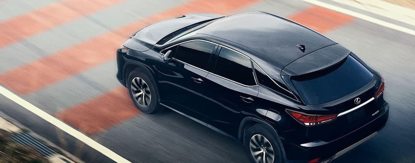 2020 Lexus RX 350 in black driving down track