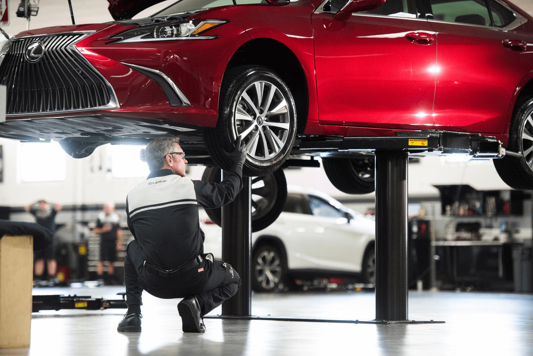 Lexus Warranty Coverage Tech Red Car Lift