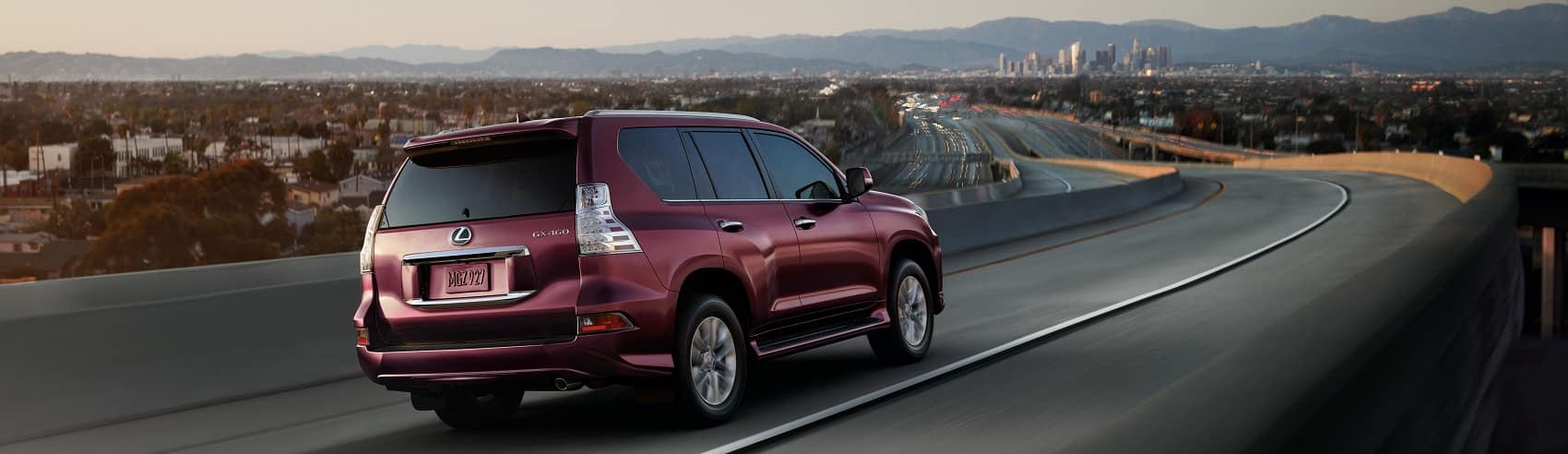 2020 Lexus GX red driving down the highway