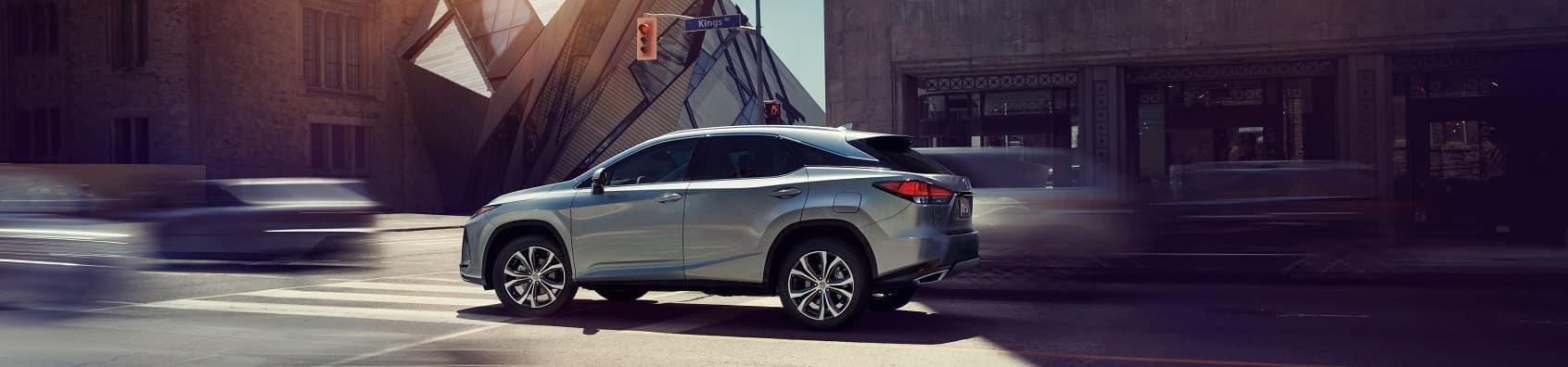 2021 Lexus UX Hybrid driving through the city