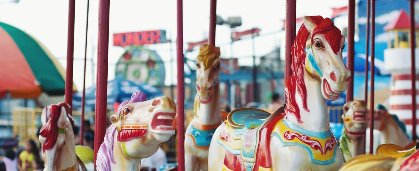 amusement park carousel with horses