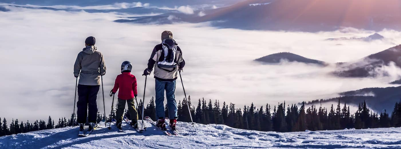 family skiing on a mountain