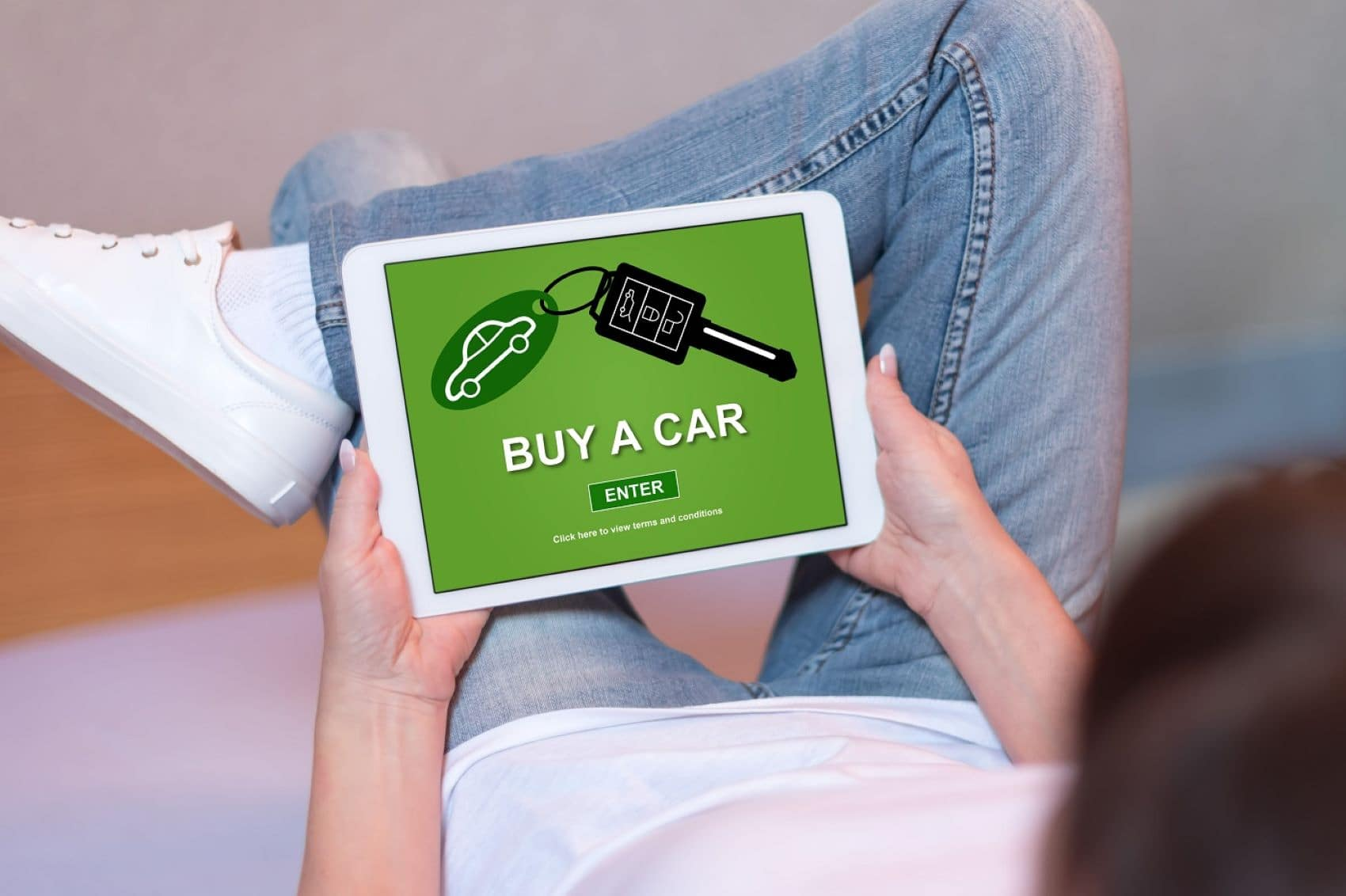 Woman buying a car online using a tablet