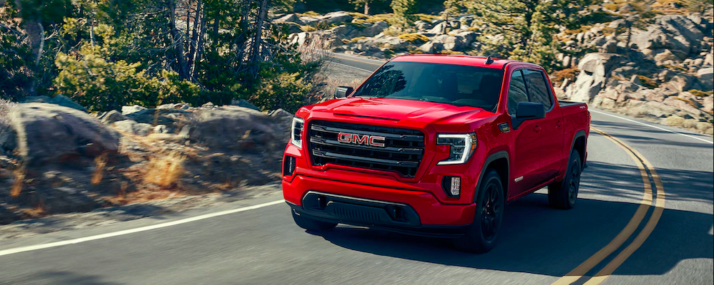 2020 gmc sierra red exterior driving down road