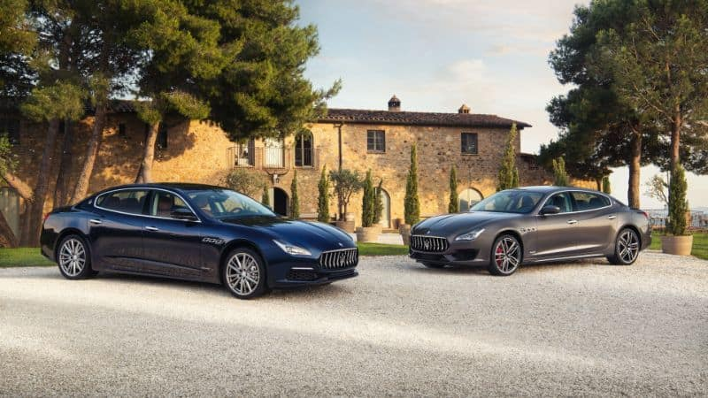2 Maserati Quattroporte models parked in a driveway in Italy
