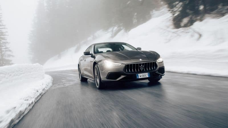 A 2020 Maserati Ghibli driving on a slick road