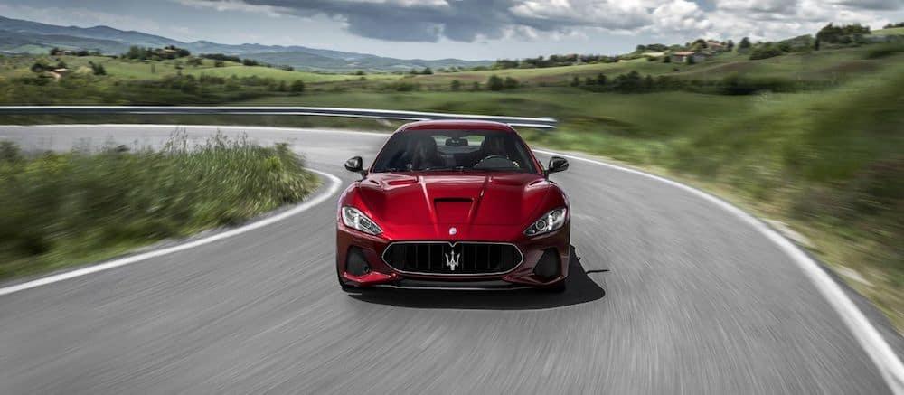 A 2020 Maserati Granturismo taking a corner on a track