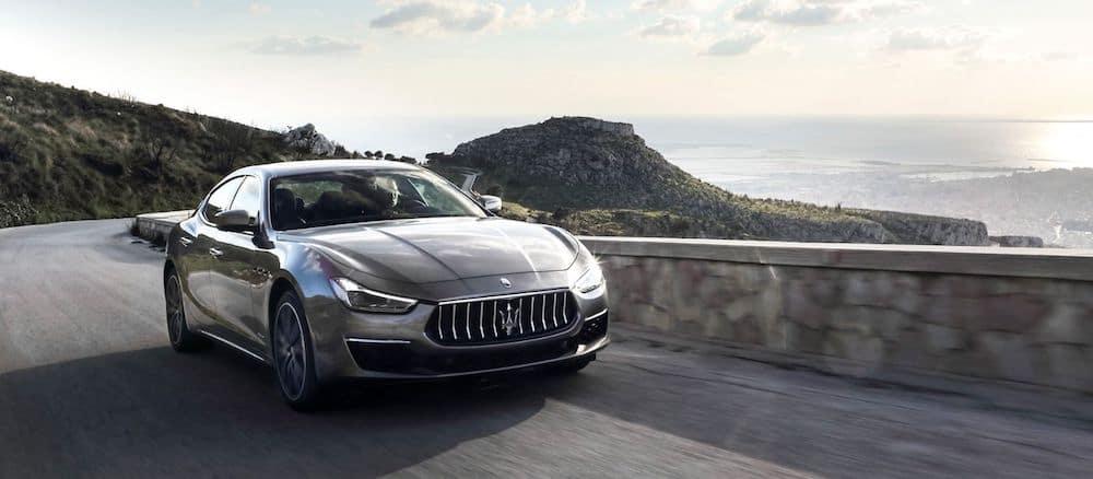A 2020 Maserati Ghibli driving on a mountain road