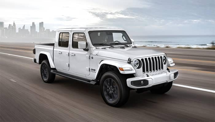 Jeep Gladiator Driving Away From City