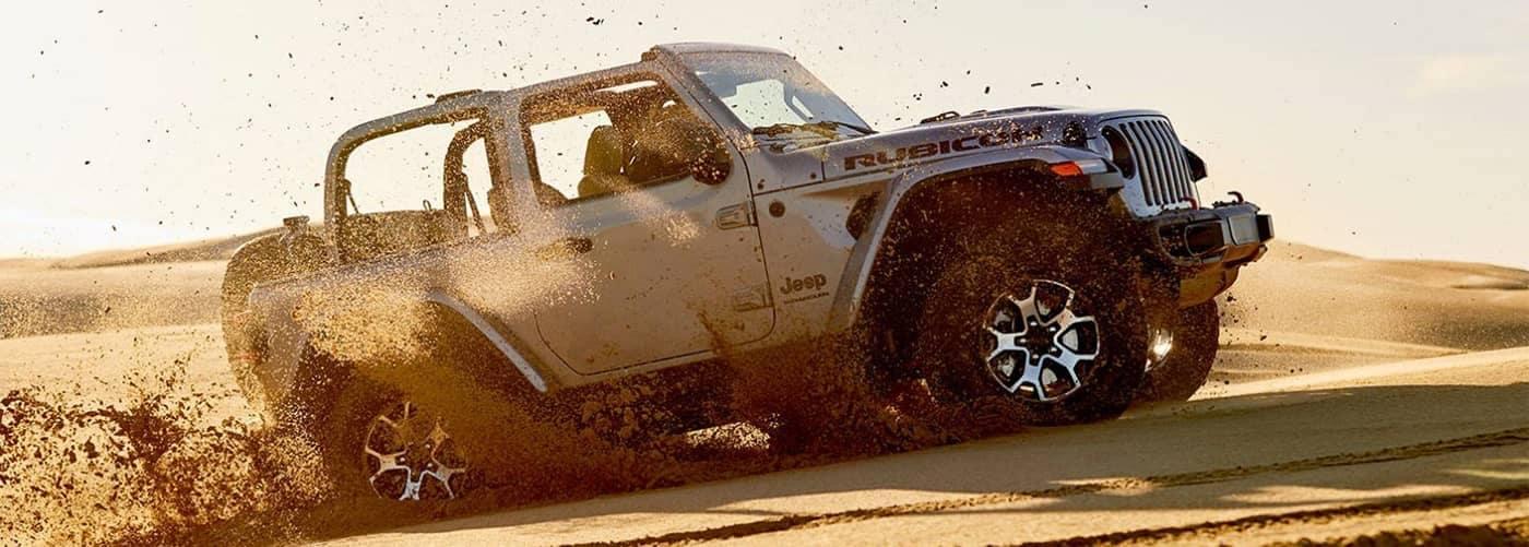 Jeep Wrangler Off-Roading Through Sand