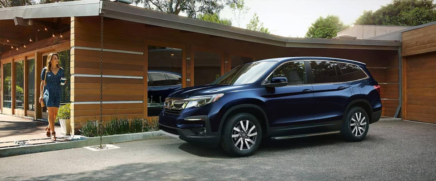 A young woman walking towards her Honda Pilot that she is selling online.