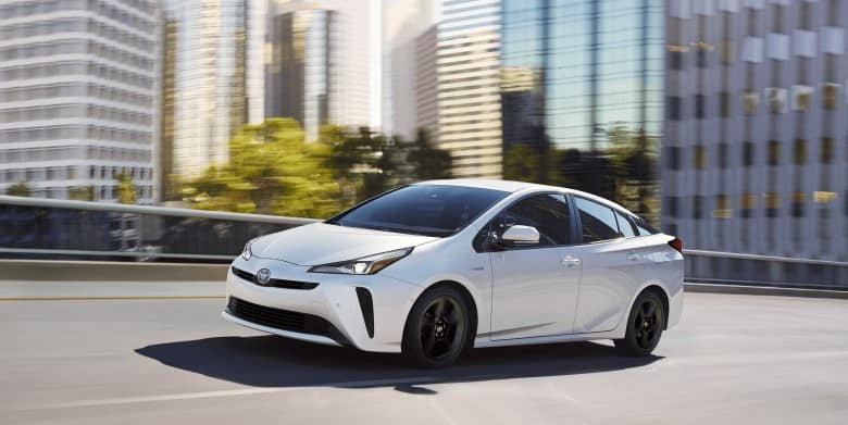 The Toyota Prius drives in a city
