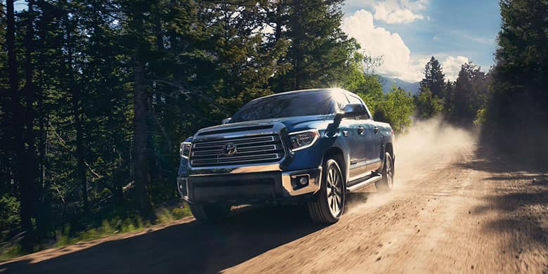 A Toyota Tundra drives in the country